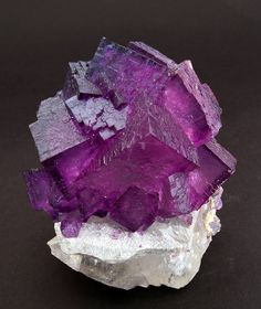 "Fluorite with Calcite FM6F7: This group of crystals has a structure and color that are really attractive, even more so when light enters the center. They are also well placed on the Calcite. Elmwood Mine, Carthage, Smith County, Tennessee  USA (±1993)  Specimen size: 4.9 × 4.6 × 3 cm = 1.9"" × 1.8"" × 1.2""  Main crystal size: 1.7 × 1.2 cm = 0.7"" × 0.5"""