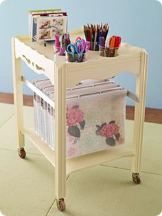 Take an old table, cut some holes in the top for cups, paint, add some wheels….and you have a fabulous rolling craft station!  You could even roll it right into a closet when you're not using it! ~ Great repurposing project!