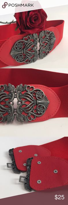"Stretch Belt - Red w/Pewter Front-Close Buckle Such a versatile belt!  Wear over tops or dresses to add a little flair and change the look of your outfit.  Belt measures 13"" lying flat, so would fit a 26"" - 29"" waist comfortably. Accessories Belts"