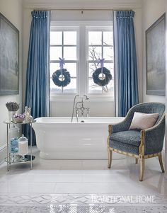 <p>Glistening silver ornaments and swags of Blue and lavender ribbons shimmer on a 16-foot-tall tree, lighting up a serene blue-and-gray palette for the holidays</p>