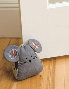 I had so much fun making the mouse door stopper and door draft blocker from the Parlor Pets fabric collection. Door Draught Stopper, Draft Stopper, Diy Door Stopper, Sewing Toys, Sewing Crafts, Doorstop Pattern, Softies, Door Draft, Mouse Crafts