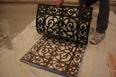Rubber mat on cabinet doors-neat! You could even do this on canvas for a piece of art :)