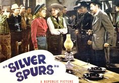 We could print a bunch of old Western movie posters again this year as decorations.  There are a million images online we could use to print...just google Roy Rogers to start!  I even like the table setting in this movie scene...!
