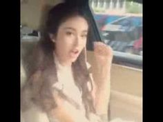 Asian girl dancing WHILE DRIVING. Kind of proves the stereotype that asian women are bad drivers lol.