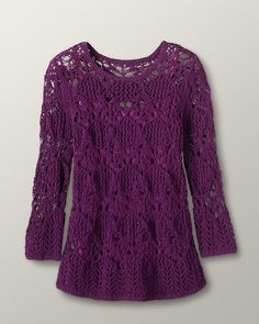 ribbon yarn and lots of openwork - this is a gorgeous top from coldwater creek.  Machine washable too!