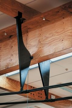 The tensile truss supporting the sports court roof are a hoe or paddle derivation. Otaki, New Zealand