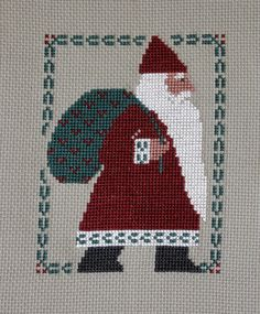 Completed cross stitch Prairie Schooler Santa Claus. $12.00, via Etsy.