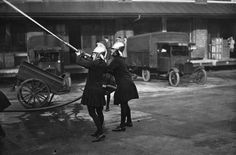 1928, Two firefighters during a drill. | 25 Stunning Vintage Photographs Of Female Firefighters