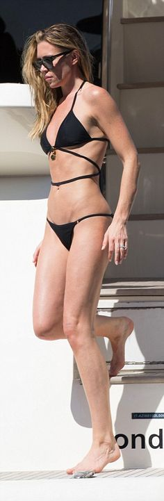 Abbey Clancy shows off her incredible physique in barely-there bikini