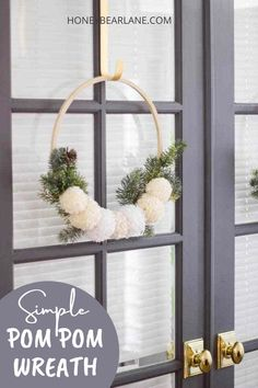 Make this simple pine and pom pom wreath to add a little whimsy and homemade style to your Christmas decor. It works for the entire winter! Pom pom crafts. Wreaths for front door. Wreath diy. Fun Diy Crafts, Diy Craft Projects, Home Crafts, Pom Pom Wreath, Diy Wreath, Pom Poms, Christmas Crafts, Christmas Decorations, Pom Pom Crafts