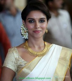 The Kerala saree is timeless. Team it with lots of mullappoo (jasmine flowers) and traditional jewellery and you have a winner. Asin in a cream bridal kerala saree #indian #wedding