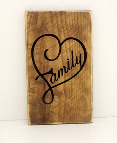 ~Family~ Sign Reclaimed Rustic Cedar Wood Sign Wood Sign Measurements: Width- 5 Height- 9 This unique rustic décor sign was made from reclaimed cedar fence boards. The Wording is done in a high quality Black Vinyl.  A Sawtooth picture hanger will be included. We can do custom sizes upon request- let us know what you may be looking for. For additional questions or concerns please feel free to contact us