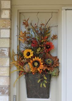 Fall Front Porch Door Decor...gorgeous flowers in a metal container.