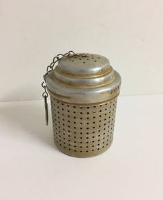 Vintage aluminum strainer. Used for loose leaf tea. Dip it into your tea cup or pot. Large size. Measures 3 3/4H x 2 1/4 in Diameter.