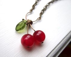 Cherry Necklace with Pink Agate and Glass Leaf Beads - Cherries Jubilee by littlehappybluebird on Etsy https://www.etsy.com/listing/71828663/cherry-necklace-with-pink-agate-and