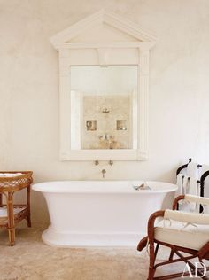 BEACH BATHROOM BY GENEVIEVE FAURE  In the master bathroom of a Dominican Republic estate, the wall mirror framed in a door pediment is antiq...