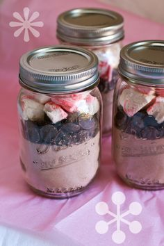 Homemade peppermint candy cane marshmallows, hot chocolate mix, and chocolate morsels. Layered in mason jars. Very cute idea for Christmas gifts this year.