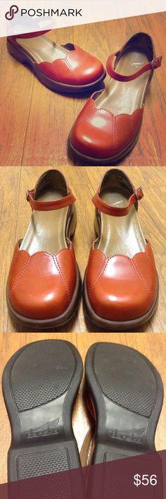 Dansko Dansko shoes, maryjane style. Beautiful condition, brick red color upper with brown bottom. Dansko size 39 Dansko Shoes