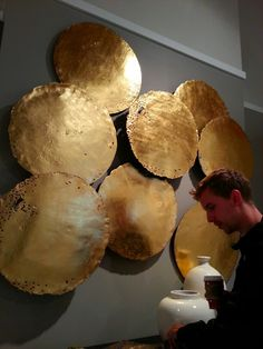 Recycled oil drum heads painted gold and hung on the walls