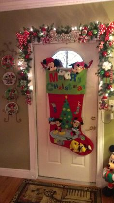 Mickey and Minnie Christmas door decor. Wow what a stocking. I love the plates.