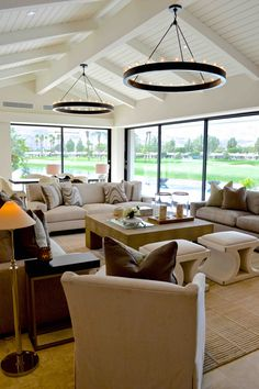 A Living Room in a seasonal client's winter home. Layered textured neutrals against a background of a colorful country club golf course view creates this space that is seamless from inside to out! #InteriorDesign #InteriorDesigner #Interior #Design #Designer #CountryClub #GolfCourse #HouseTour #CurrentDesignSituation #HomeRenovation #DannInc #DannFann