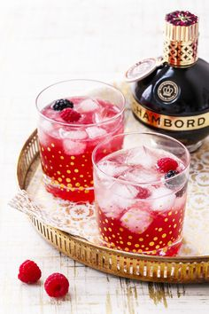 A fresh and fruity cocktail recipe made with fresh raspberries and blackberries, vodka, Chambord, a dash of bitters, and a splash of club soda. Fun and festive and a perfect New Year's Eve cocktail recipe or any celebration! New Year's Eve Cocktails, Fruity Cocktails, Cocktail Drinks, Cocktail Recipes, Alcoholic Drinks, Beverages, Cocktail Ideas, Drink Recipes, Chambord Cocktails