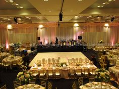 Jill  Tim's lighting and décor design began with a soft, elegant ivory fabric backdrop at the Hotel Arista in Naperville, IL!