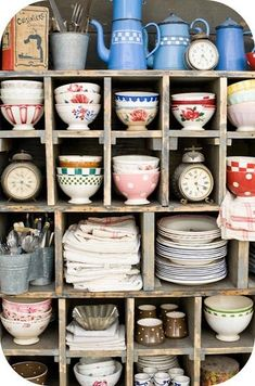 mismatched dishes of all colors, sizes, floral patters - preferably plates, dessert plates, serving dishes, and bowls