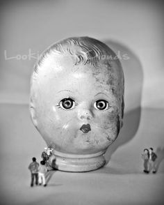 vintage doll head with miniatures unusual perspective striking eyes Doll Museum 8 x 10 fine art photograph black and white. Shop: LookingAtClouds