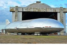 The Aeroscraft Airship sits outside the massive hanger in Tustin, California after its many year gestation. It rests on hovercraft pads instead of wheels.