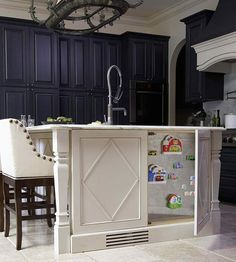 Create seamless storage with door fronts that look like decorative panels. A push latch opens these panels to reveal space on the end of the island. *Use on back side of island to access open storage space* Kitchen Island Storage, Kitchen Redo, Kitchen Remodel, Kitchen Design, Kitchen Ideas, Kitchen Islands, Ivory Kitchen, Kitchen Cabinets, Kitchen Board