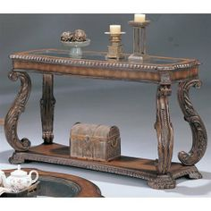 Sofa Table with Hand Carved Leaf in Antique Finish by Coaster Home Furnishings, http://www.amazon.com/dp/B000X260IG/ref=cm_sw_r_pi_dp_Oxzjrb0FGE9F0 $384