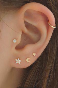 Create your own ear stack with these dainty ear piercings and hoops!  #earpiercings #daintypiercings #curatedear #earstack #piercings #14kgoldstuds #earcandy #daintyjewelry #cartilagepiercings #earlobe #earrings #triplepiercing #celestialearrings Pretty Ear Piercings, Ear Peircings, Multiple Ear Piercings, Ear Jewelry, Dainty Jewelry, Cute Jewelry, Body Jewelry, Jewellery, Triple Ear Piercing