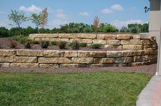 "Retaining wall constructed with 14"" ledgerock limestone. #TopekaLandscape"