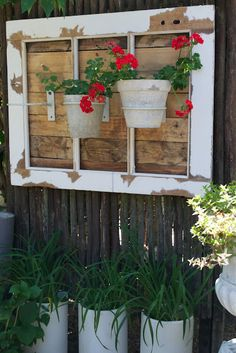 Fence Decor with old windows & pots