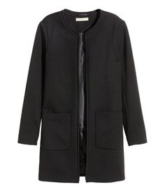 Short, straight-cut jacket in textured-weave fabric with front pockets and no buttons. Lined.