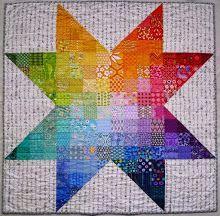 http://steffiscandyquilts.blogspot.com/2012/09/the-rainbow-star-quilt.html