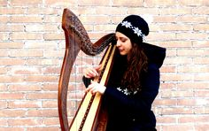 """This is a photograph Rachele Spizzo took while I was singing my celtic harp and voice cover of """"Winter"""" by Tori Amos: you can find it on my YouTube Channel!"""
