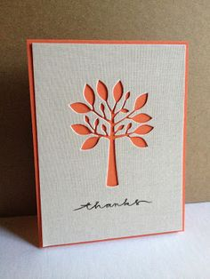 handmade card from I'm in Haven: Autumn Tree ... clean and simple design ... negative space die cut tree shows coral card  base ... luv it!