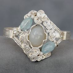 silver wire wrapped bracelet with moonstone cabochon and aquamarine beads