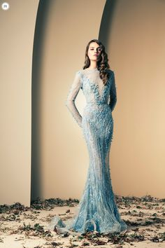 """""""Ziad Nekad Haute Couture Fall-Winter 2013-2014."""" She looks like she belongs in that Disney movie, """"Frozen."""" They should have made a wintry background."""