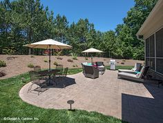 This patio is the perfect spot for summer lounging! The Travis home design #1350.