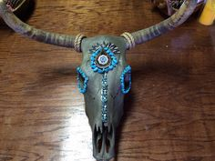 A personal favorite from my Etsy shop https://www.etsy.com/listing/255746714/decorated-cow-skull