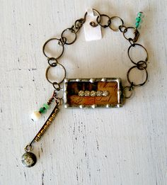 https://www.facebook.com/ilovechartreuse    Hand made jewelry with glass beads, rhinestones, charms and welded pieces!
