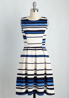 You've planned the perfect get-together for your best friends reunion - tea, talk, and this striped dress! As you sip your steamy brews, your besties remark on how stylish you've become in the pleated skirt and navy, blue, and white mixed-stripe pattern of this textured A-line.
