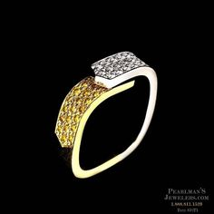 Eddie Sakamoto's platinum and 18kt yellow gold wedding band with white and fancy yellow pave set diamonds. The ring is set with 0.87 carats in diamonds.