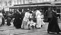 In this circa 1900 scene is filled with all sorts of things we don't see anymore: the Grand Ave streetcar; a guy driving a horse and buggy; a stroller that looks hard to navigate through the crowded streets of downtown Los Angeles; and women in long dresses and hats during the day and who are probably cinched into foundation garments of some description. In LA weather? Can you imagine?
