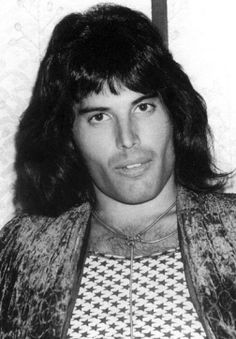 Freddy Mercury -  At one point, he was the apple of my eye when I was a kid .  I got my hair cut like this and made the kids who didn't know me on the playground call me Freddy. It was fun and I was 9. I still have no gaydar and love this talented man.  (and yes, I love his overbite..I have one too)