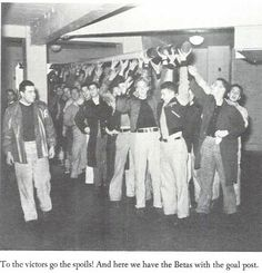 Students parade the Oregon State goalpost around Mac Court after bringing it back to Eugene after UO's civil war victory 20-0 on November 30th, 1940.  From the 1941 Oregana (University of Oregon yearbook).  www.CampusAttic.com