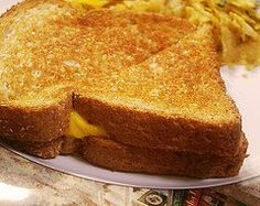 Might have to try this. Baking grilled cheese: Preheat the oven to 450 degrees F. Butter eight slices of bread and put butter-side down on cookie sheet. Top with cheese of choice. Butter eight more bread slices and place butter-side up on top of cheese. Bake in preheated oven for 6-8 minutes, flip, and bake 6-8 minutes more, until golden brown.